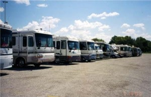 Motor homes parked in holding area.