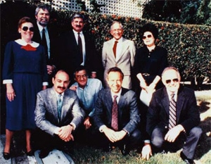 Summer 1988 -taken in front of the original Mt. View building of the employees remaining from the original 1968 staff. L to Rstanding: Jean Jones, Tom Innes, Ted Jenkins, Bob Noyce and Nobi Clark. L to R kneeling: Les Vadasz, George Chiu, Andy Grove and Gordon Moore.